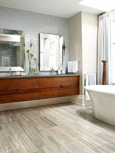 The browns and copper tones in this bathrooms Silver Copper Vein Cut floor tiles work well against the timber floating Vanity > http://www.sareenstone.com.au/products/travertine-tiles/silver-copper-vein-cut-travertine-tumbled-221