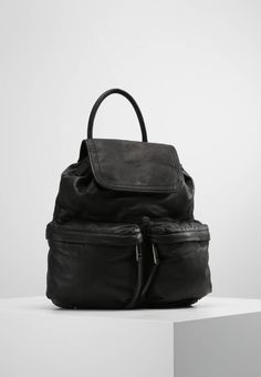 "Marc O'Polo. Rucksack - black. Pattern:plain. Fastening:Press stud. Compartments:mobile phone pocket. length:12.5 "" (Size One Size). width:5.0 "" (Size One Size). Lining:textile. carrying handle:5.5 "" (Size One Size). Outer mater..."
