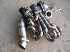 Stainless Steel Squid. turbo manifold for an AE86 (twincharged -super/turbocharged)