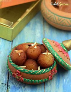 Gulab jamuns are popular all over India. Every region in India serves these khoya rounds deep fried in ghee and soaked in hot saffron flavoured syrup. The khoya or mava used for the Gulab Jamuns is of a special kind called Hariali Khoya or Chikna Khoya. Indian Desserts, Indian Sweets, Indian Dishes, Indian Food Recipes, Sweets Recipes, Jamun Recipe, Chaat Recipe, Arrowroot Flour, Arrowroot Powder