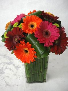 Wholesale Flowers & Supplies - purchased fresh red, orange, & yellow gerber daisies couple days before the wedding. My bridal party+ helped put the centerpieces together and arrange bridesmaids' bouquets.