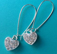 $8.00.  Perfect for Valentine's (or any other day) SPARKLE HEARTS earrings from my very favorite vendor!  :)