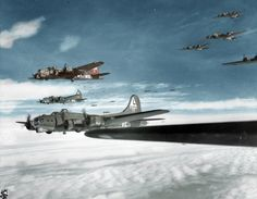 "A mix of 532nd and 535th Bomb Squadron planes from the 381st Bomb Group, 8th Air Force.Tan B17 is ""Squat 'N Droppit"" (MS-X)The nearest plane is:""Friday the 13th"" (VE-M)It was shot down by fighters near Munster,Germany on February 22,1944 mission to Oscherleben.Only 4 crew survived and Squat 'N Droppit"" caught fire while landing Declared salvage 2 days"