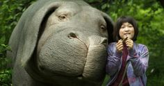 Netflix Original Movie Review: Okja Is the Must See Film of the Summer -- South Korean Director Bong Joon-ho delivers a thoughtful, visceral satire of the meat industry with his adventure thriller Okja. -- http://movieweb.com/okja-movie-review-netflix/