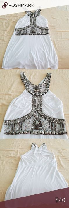 Embellished halter style top xs Boston Proper White cotton embellished shirt all various beading sequins stone work. Made in India.  Comes down to the hips and looks great with leggings or skinny jeans. Beautiful on. I even had it altered because it was too long.  But I only wore it twice. Purchased from Boston Proper high-end women's clothing.  Can fit a small or extra small person but it is an XS. Boston Proper Tops