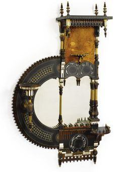 Carlo Bugatti MIRROR stained and painted wood, ivory, leather, pewter and brass, circa 1900.