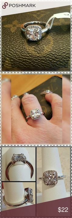 New Stainless Steel CZ Ring Size 7 Gorgeous Brand New, With Tags, Stainless Steel CZ Ring! This Dainty Ring is very beautiful & really stands out! You'll love the Center Stone with CZ's all around the edges!  Stainless Steel, Gold Plated, Rhodium Plated, & Sterling Silver all do best if kept in a plastic bag when not being worn. They'll last a long time if taken care of properly & removed when showering, sleeping, working with chemicals, etc. I'll provide a plastic bag. Shouldn't have any…
