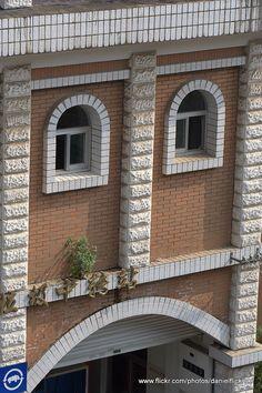 Sad face on a building