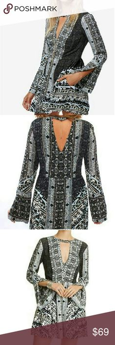 Free People Printed Tunic Dress Sz 2 & 12  NWT, BLACK COMBO. Side zip with single button closure at nape of neck. Has pockets and slit sleeve detail at cuffs, pic 1 and 5 (close-up). Free People Dresses Mini