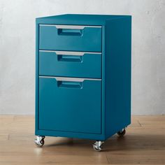 "Shop TPS 3-drawer teal file cabinet. File under ""industrial. "" Mechanic-shop chic powdercoated teal stacks one letter/legal drawer and 2 additional drawers for extra organization. Stainless steel drawer grips; four casters (front two lock). TPS teal 3-drawer filing cabinet is a CB2 exclusive."