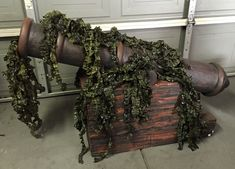 Here's a picture of my cannon. Made some garbage bag seaweed. I can't believe how easy it was to make. I'm going to have a couple garbage bags full made. I plan on putting a bunch of it down around the bottom of the ship we made. Along with spreading it through the display.