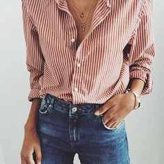 Leave a few buttons unbuttoned and pile on some minimalist gold necklaces.