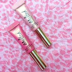 """NEW too faced metal melted minis WILL SELL SEPERATELY! ($10 per) NEW and SWATCHED (twice) metal melted minis by too faced. Bright pink is """"melted metallic macaron"""" and lighter pink is """"melted metallic peony"""". Both are beautiful statement colors. Because the peony is lighter IMO that is the more metal affect one of the two colors. The bright pink absorbs the metallic undertones but still translates beautifully! Too Faced Makeup Lip Balm & Gloss"""