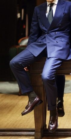 Classic & Sophisticated! Navy double breasted suit, solid color tie, and dark brown tasseled loafers.