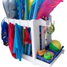 Organize all of your summer pool toys with this outdoor caddy. We love the side hooks perfect for pool towels!