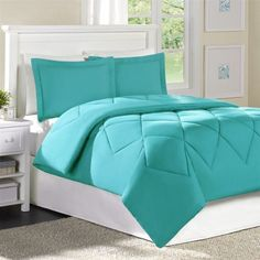 "Main Street Conrad Mini Comforter Set - Turq Cove/Turq Cove - Full/Queen by Main Street. $49.99. Set Includes: 1 Comforter, 2 shams. Size: F/Q: 86x90""/20x26+2""(2). The Conrad comforter and sham set is perfect for any room in your home. The solid Turquoise color i. Patten: Solid. Material: Polyester. The Conrad comforter and sham set is perfect for any room in your home. The solid Turquoise color is versatile and will match perfectly with your décor. 95gsm microfiber solid..."