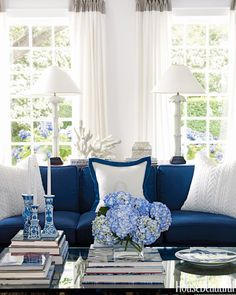 Darker shades have a buttoned-up elegance that make you sit up straight. Click through for more blue decor ideas.