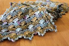 Petit Tricotage made this version of the Noro Catherine Wheel Scarf using Monet-inspired colors