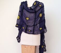 This elegant yet modern, nuno felted scarf is perfect for adding a feminine touch to your outfit. Its a large, yellow and purple, silk scarf which can be worn as a shawl/evening wrap for that special occasion, or spruce up a casual outfit. Loosely wrapped or bunched around your neck, either way this sheer, spring scarf is an art to wear thats bound to get peoples attention.  This wool and silk, felted shawl will keep you warm and let your skin breathe, perfect year round.  The geometric ...
