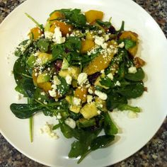 Arugula and spinach salad with roasted beets, avocado, orange segments, pumpkin seeds, feta cheese, shallots, cranberry and walnuts in a balsamic and blood orange olive oil vinaigrette. www.yummiyogini.com
