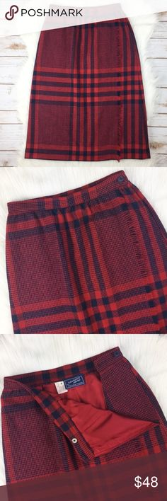 """Plaid Knee Length Skirt Plaid skirt . Red/navy. Lined. Faux wrap - fringe lined vertical down front is sewn. Button closure w/ second, interior button as back up. One pocket on right side (when wearing); no pocket on left - 4th image shows space leading to button closure. Tag w/ fabric info removed - my guess is that the shell is a wool blend and lining is polyester. *Dry clean*. Measurements on one side, laid flat: Length 25"""" from top of waist band to hem. Waist 11.5"""" across. Hem 20""""…"""