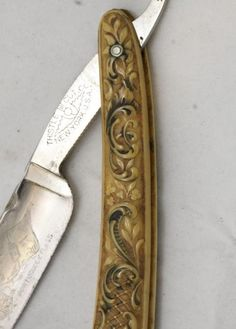 Co. New York USA. Co. New York USA. Rounded imitation ivory handle has raised scroll and -