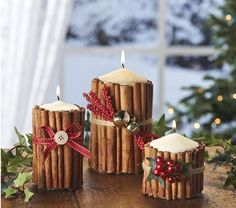 Red ribbon and berries add a festive touch to cinnamon candles, these centerpieces would be great for Christmas dinner or a Christmas themed wedding