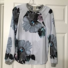 Stunning semi sheer light floral blouse!! Size Medium- fits a small - very lightweight beautiful spring colors/ exposed zip back closure Tops Blouses