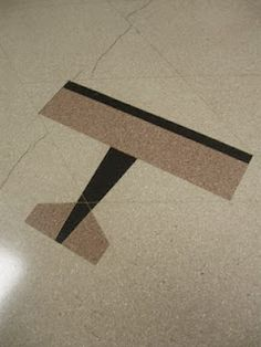 What famous Chicago building has transportation inlays in its basement-level floor? CBOT building in the financial district.