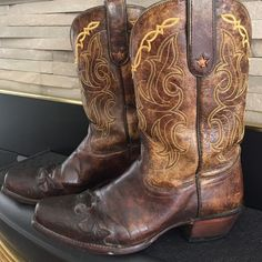 Tony Lama cowboy boots.  Brown awesome cowboy boots, worn with love, wear to heel and soles, as shown.  These boots will last a lifetime, sturdy and quality made.  Style #6004. Tony Lama Shoes