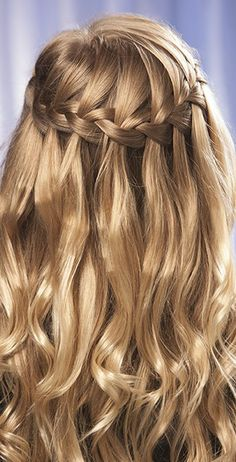 Gorgeous long wedding hair in a waterfall braid. If you're hair just isn't long enough for this type of style, try reliable remedies to make your hair grow faster in advance. Learn these tips and more at: http://www.hairperfecter.com/how-to-get-your-hair-to-grow-faster/