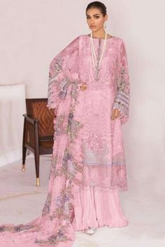Smartly designed for women on the go, this pink net sharara suit which will surely tell them that the diamonds aren't the only beautiful thing which they have seen. This round neck and full sleeve wedding wear sharara suit beautified with thread and sequins work. Completed with cotton sharara pants in pink color with pink net dupatta. Sharara pants are plain. #shararasuits #malaysia #Indianwear #weddingwear #andaazfashion Indian Attire, Indian Wear, Pantalon Cigarette, Sharara Suit, Wear Store, Straight Cut, Wedding Wear, Asian Woman, Costume