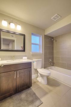 Contemporary Full Bathroom with Porcelain Fusion Bianco, Winstead Cabinets, Caleigh 3 Light Vanity Light by Kichler
