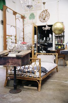 rattan daybed and other home furnishings and decor on display at elsie green / sfgirlbybay