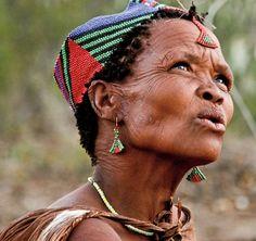 Xai Xai, Kalahari Desert, Botswana. Female Elder wearing a beautifully beaded cap.