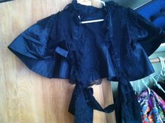 evil/black shawl/wardrobe