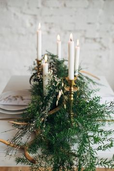 Tablescape with white candles and ferns