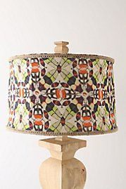 I love pattern shades! This is so funky! I like the wood lamp base as well.