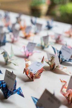pretty paper crane wedding escort cards at reception                                                                                                                                                                                 More