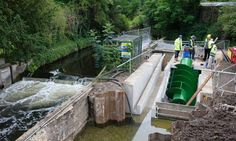 Small-scale renewable energy from rivers: The 'Archimedes screw' turbine is manoeuvred into place in the River Wandle.