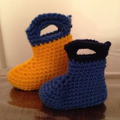 Fisherman rainboot style baby booties. I'm not keen on the colours or yarn I used making these (hence only one if each size made). Will be trying the pattern again when my next yarn order arrives.  Pattern free from http://www.repeatcrafterme.com/2012/03/crochet-rain-boots.html