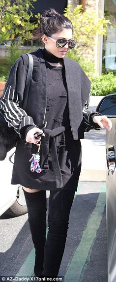 Sexy boot-wearing Kylie Jenner surrounds herself in friends and fashion as she moves on from breakup with Tyga | Daily Mail Online