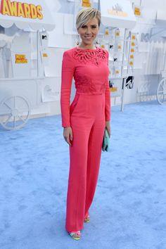 Scarlett Johansson when she walked the red carpet at the MTV Movie Awards on Sunday in a hot-pink jumpsuit.