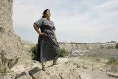 Cecelia Fire Thunder, the first female president of the Oglala Sioux Tribe, stands on the Pine Ridge Indian Reservation in an area of the Badlands outside of Kyle, South Dakota on Wednesday, July 19, 2006.