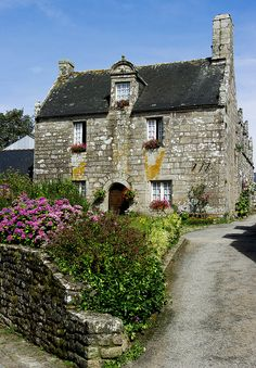 A stone house and garden in Locronan, Brittany, France