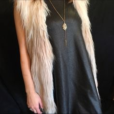 Gorgeous Ivory, Grey Faux Fur Vest This vest is absolutely stunning! It is the softest Fur Vest I have ever carried in my boutique! The coloring on this vest is jaw dropping; it's a Ivory, Blush, Light Grey color & I am in love! Fully lined, 100% Polyester! Available in S/M Only! [[ Comment so I can make you a new listing! ]] Southern Lush Boutique Jackets & Coats Vests