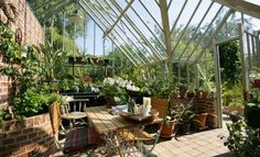 Futuristic Home Interior Design Ideas - NHG Greenhouse Kitchen, Build A Greenhouse, Greenhouse Restaurant, Greenhouse Tomatoes, Greenhouse Ideas, Traditional Greenhouses, Green House Design, Green House Cafe, Wooden Greenhouses