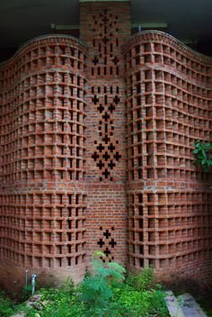 Laurie Baker - Women's Dormitory at the Centre for Development Studies, located in Ulloor, Trivandrum, completed in 1971 This building features some of Baker's most vitruosic brick work. Two curved jali walls fan outward from a central spine, creating a breezy, shaded shared corridor space. The monolithic walls rise up two and a half stories, and end in a handrail on the third storey balcony. Private rooms are located at the back of the building, shielded from the public walkway.