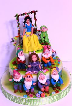 Snow White and the seven dwarfs cake. Such unimaginable talent