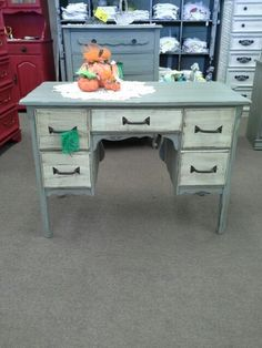 $159 - This shabby chic 5 drawer desk could also be used as a vanity with the addition of a mirror. It is painted gray with cream colored drawer faces, distressed and finished with hand applied tinted wax. **** In Booth A8 at Main Street Antique Mall 7260 E Main St (east of Power RD on MAIN STREET) Mesa Az 85207 **** Open 7 days a week 10:00AM-5:30PM **** Call for more information 480 924 1122 **** We Accept cash, debit, VISA, Mastercard, Discover or American Express